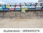 Small photo of Beach huts at Walton on the Naze, Beach Huts, Essex, England, beach huts are traditional seaside feature for people to change or base themselves. Walton-on-naze, Essex, UK