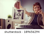 Stock photo young friendly guy video calling and showing a cat s picture 189656294