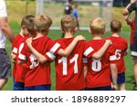 Small photo of Youth Soccer Team Substitute Players. Boys Standing in a Row Huddling During Penalty Kicks. Football Tournament Competition for Kids