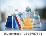 Small photo of Glass test tubes with liquid stand on a table in a chemical laboratory. Checking the quality of petroleum products refining concept.