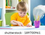 child drawing with pencils... | Shutterstock . vector #189700961