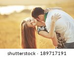happy teen couple embracing.... | Shutterstock . vector #189717191