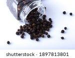 Pepper In Glass Jar On Black...