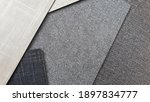 Small photo of composition of interior fabric laminated samples in various texture and color (grey tone). laminated used for wall covering or furniture finishing.