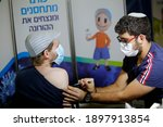 A Medical Worker Inoculates A...