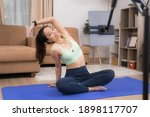 asian woman exercising at home  ...   Shutterstock . vector #1898117707