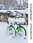 Two Green Bicycles Are Piled...