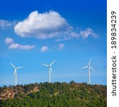 Small photo of Aerogenerator windmills in the mountain top in a pine tree forest