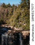 Small photo of Blackwater Falls State Park in the Allegheny Mountains of Tucker County, West Virginia, USA, a 62-foot cascade waterfall in late Autumn, November