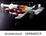 narcotics on black table with... | Shutterstock . vector #189868319
