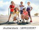 Cute children with soccer ball...