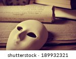 a pile of books and a mask ... | Shutterstock . vector #189932321