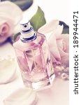 perfume bottle and roses. retro ...   Shutterstock . vector #189944471