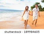 beach couple walking on... | Shutterstock . vector #189984605