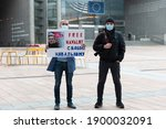Small photo of BRUSSELS, BELGIUM - JAN 19 2021: Two men hold a sign demanding the liberation of Alexei Navalny, Russian opposition leader, who was detained upon his return to Russia on January 19, 2021.
