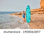 Lady In Swimsuit With Surfboard....