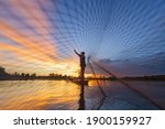 Fisherman Casting His Net On...