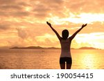 cheering woman open arms to... | Shutterstock . vector #190054415