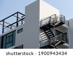 Small photo of fire escape stair steel. black outdoor metal stair of building.