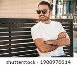 Portrait Of Handsome Smiling...