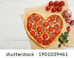 Heart shaped italian pizza with ...