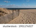 A Wooden Fence Surrounds The...