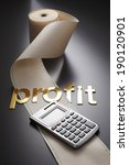Small photo of adding machine tape and calculator with word profit