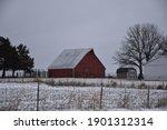 Red Barn In A Snowy Field