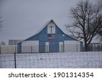 Blue Barn With A Cross And An...