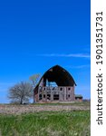 A Dilapitated Barn In Springtime