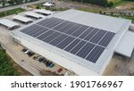 Small photo of Solar panels on factory roof photovoltaic solar panels absorb sunlight as a source of energy to generate electricity creating sustainable energy