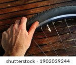 A Hand Manipulating A Bicycle...