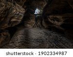 Dark Cave Feature With Sandy...