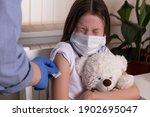 Doctor Holding Syringe And...