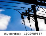 A Silhouette Of A Power Pole...