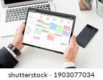 businessman using calendar app...