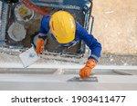 Construction Worker Plastering...