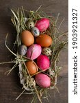 Easter Eggs In A Straw Nest On...