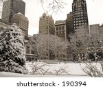 This is a snowy view of some buildings from Bryant Park in Manhattan. - stock photo
