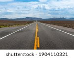 View of the US route 50 (known as the Loneliest Road in America) in the State of Nevada, USA. Concept for travel in America and road trip.