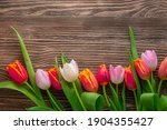 Bouquet Of Tulips On A Wooden...