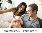 young couple with their newborn ... | Shutterstock . vector #190452671