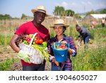 portrait of happy farmers with...