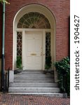 A White Arched Doorway In The...