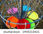 Disc golf basket with discs....