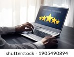 man rating his experience using ... | Shutterstock . vector #1905490894