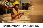Young African Female Warehouse...