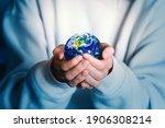 Human Holds Earth Planet Globe. ...