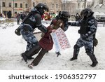 """Small photo of Moscow, Russia - 31 January 2021, Mass Protests In Russia Call For Alexei Navalny's Release. Police arrest a protestant. A girl holds a poster """"Freedom to Putin from office!"""""""