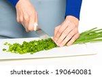 cook is chopping green onion ... | Shutterstock . vector #190640081